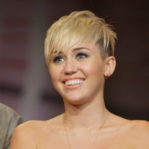 Miley Cyrus Cusses a Paparazzo Who Asks If She's Pregnant